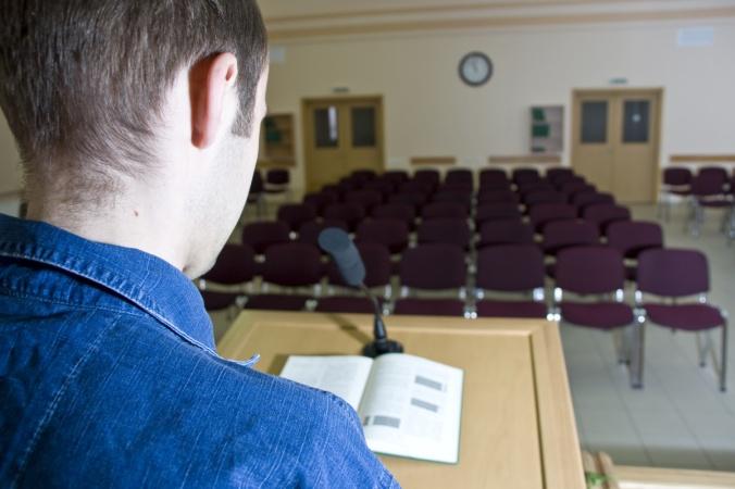 Speaker at work and empty auditorium